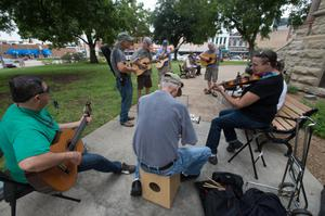Primary view of object titled '[Musicians in front of Denton County Courthouse]'.